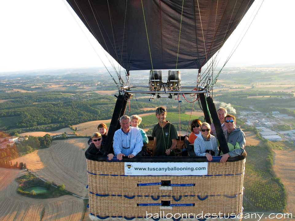 balloon in flight over tuscany